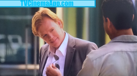 TVCinemaApp.com - CSI Miami: Eric Delko (Adam Rodriguez) with The Eyeglasses He Promised Horatio Caine (David Stephen Caruso) to Get for Him, as a gift.