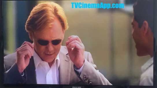 TVCinemaApp.com - CSI Miami: Horatio Caine (David Stephen Caruso) putting the eyeglasses Eric Delko (Adam Rodriguez) has brought for him as a gift on.