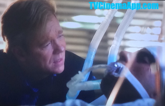 TVCinemaApp.com - CSI Miami: Horatio Caine (David Stephen Caruso) in hospital worried about Eric Delko (Adam Rodriguez) who has been shot by Calleigh Duquesne (Emily Procter).